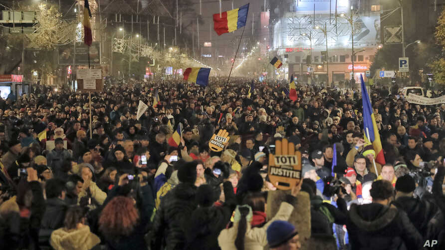 Protesters rallying against changes in tax and justice laws fill a main boulevard in Bucharest, Romania, Nov. 26, 2017.