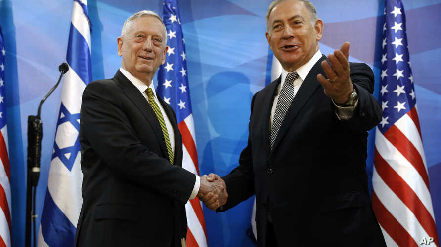 Israeli Prime Minister Benjamin Netanyahu , right, welcomes U.S. Defense Secretary James Mattis in his offices in Jerusalem, April 21, 2017.