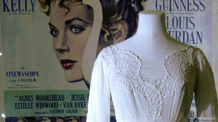 """FILE - A mannequin is seen with a dress worn by Grace Kelly in the film """"The Swan"""" in an exhibition of the late star's wardrobe at the Victoria and Albert Museum in London, April 15, 2010."""