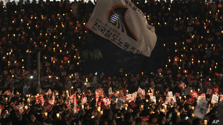 South Korean protesters stage a rally calling for South Korean President Park Geun-hye to step down in downtown Seoul, South Korea, Nov. 5, 2016.