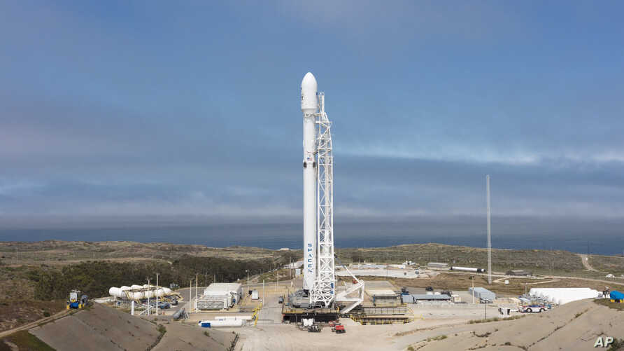 In this Sunday, June 25, 2017, photo released by SpaceX, a SpaceX Falcon 9 rocket is seen before lift off, carrying 10 more satellites for Iridium Communications, from Vandenberg Air Force Base, Calif.