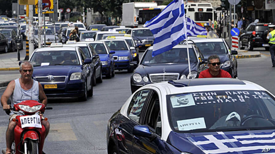 Striking taxi drivers protest part of the country's fiscal recovery program by driving their cars in convoy through the streets of Thessaloniki, Greece, July 20, 2011
