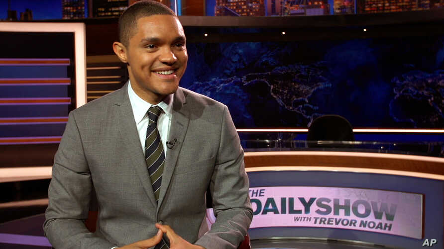 """Trevor Noah appears on the set of his new show, """"The Daily Show with Trevor Noah,"""" in New York, Sept. 25, 2015."""