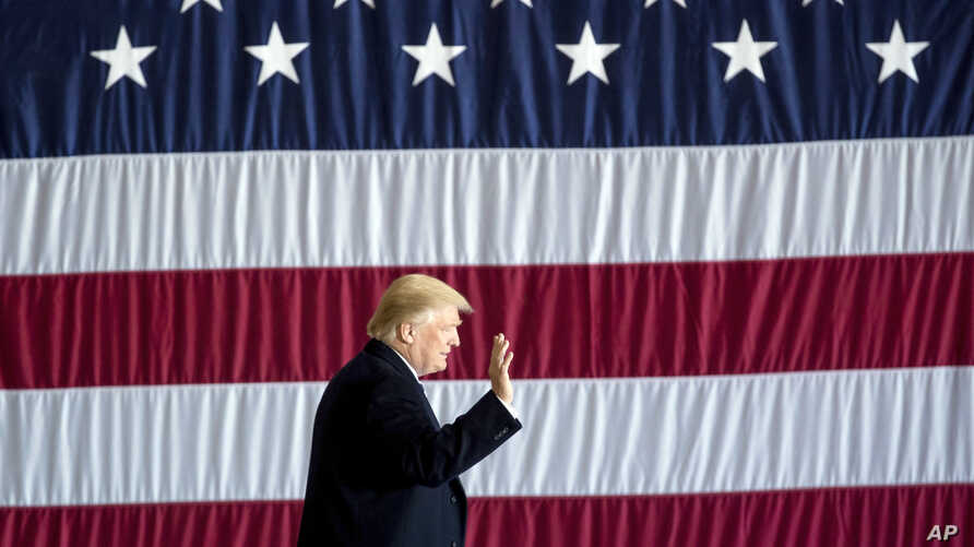 President-elect Donald Trump arrives for a rally in a DOW Chemical Hanger at Baton Rouge Metropolitan Airport, Dec. 9, 2016, in Baton Rouge, Louisiana.