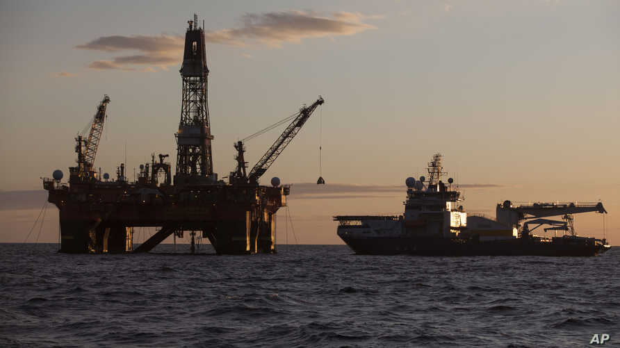 FILE - In this photo provided by the Rosneft company, a Russian drilling platform is seen anchored at the Cara Sea some 250 km (156 miles) north off the Russian shore Sept. 18, 2014.