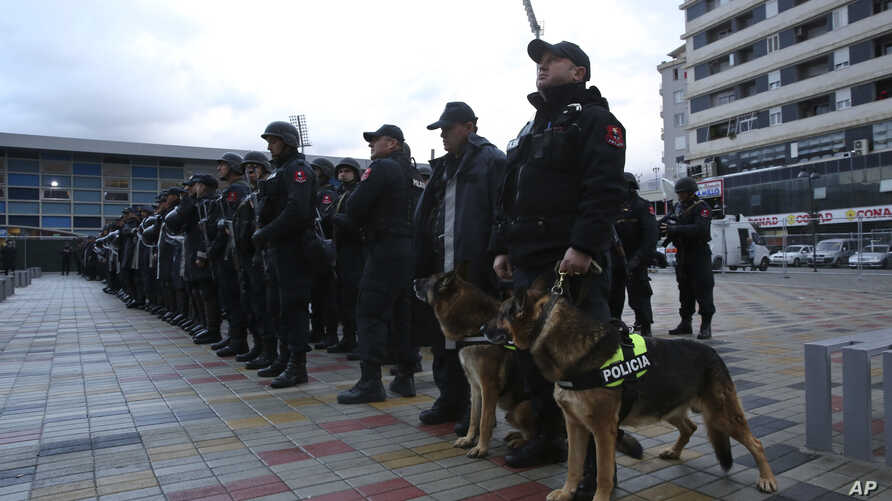 Albanian police line up in front of Elbasan Arena stadium ahead of Albania's World Cup 2018 qualifying soccer match against Israel under tight security measures in Elbasan, 50 kilometers (30 miles) south of  Tirana, Nov. 12, 2016. Police took extreme