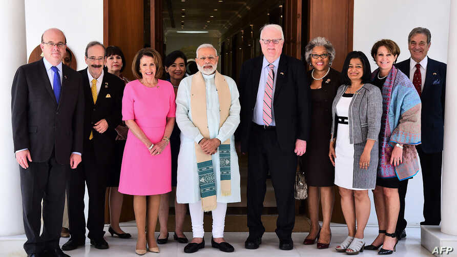 A U.S. congressional delegation, including Reps. Nancy Pelosi, center left, Jim McGovern, left, and Jim Sensenbrenner, center right, pose ahead of a meeting in New Delhi with India's Prime Minister Narendra Modi, center, in this handout photo from th