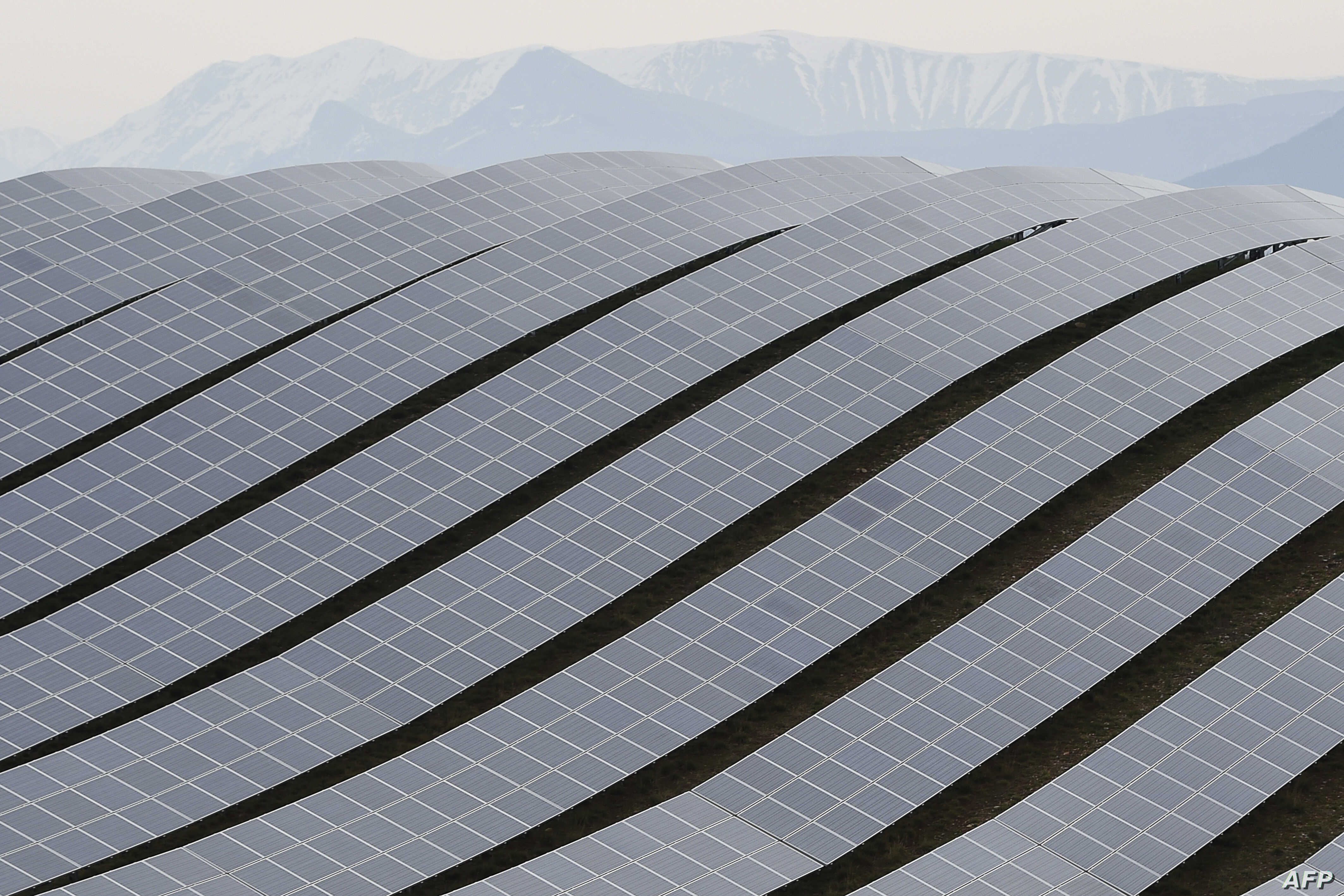 Solar panels are seen at the Les Mees solar power plant in Les Mees, southern France, March 20, 2015.