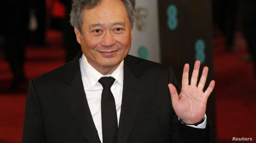 Director Ang Lee poses as he arrives for the British Academy of Film and Arts awards ceremony at the Royal Opera House in London, Feb. 10, 2013.
