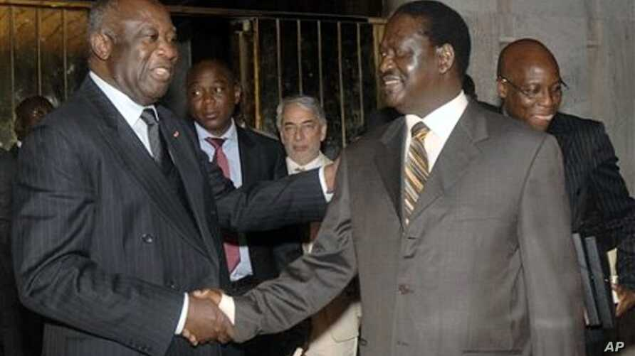 Laurent Gbagbo, left, shakes hands with Kenyan Prime Minister Raila Odinga, an African Union envoy sent to mediate the ongoing Ivorian political standoff, at the presidential palace in Abidjan, Ivory Coast, 17 Jan 2011