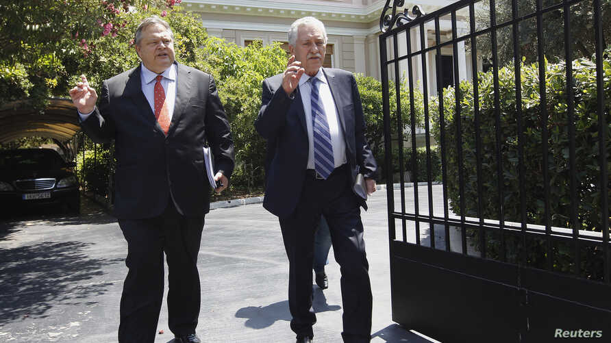 Leader of Panhellenic Socialist Movement party Evangelos Venizelos (L) and Leader of the Democratic Left party Fotis Kouvelis leave the Prime Minister's office after a meeting in Athens, Greece, July 18, 2012.