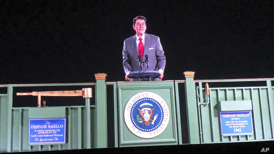 Former President Ronald Reagan appears on a railcar platform making a speech during a whistle stop on the campaign trail, but as a hologram, on display at the Ronald Reagan Presidential Library in Simi Valley, Calif., Oct. 10, 2018.