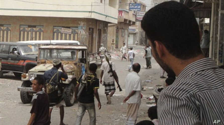 Armed men patrol the streets of the Yemeni southern town of Radfan, to enforce a strike called by the Southern Movement separatists, 07 Jul 2010