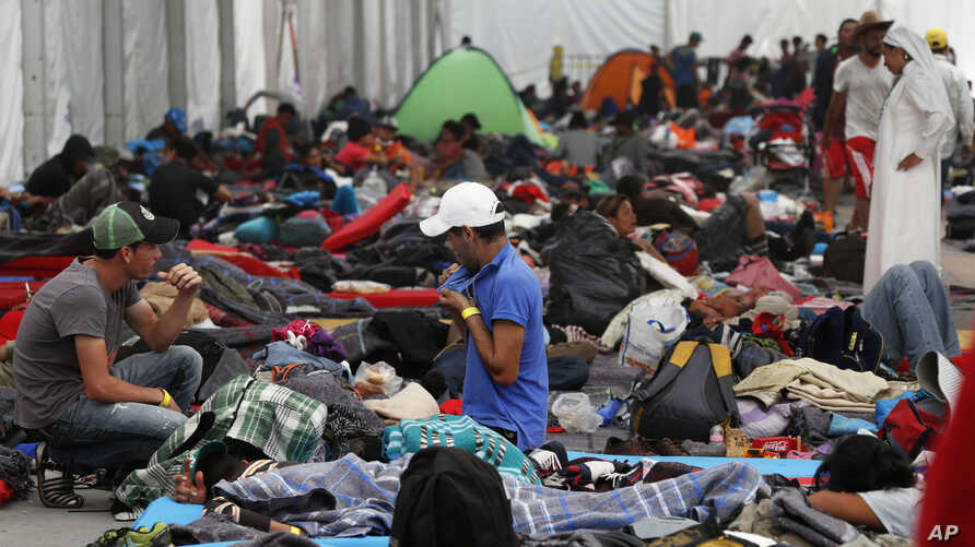 Central American migrants settle in a shelter at the Jesus Martinez stadium in Mexico City, Tuesday, Nov. 6, 2018. Humanitarian aid converged around the stadium in Mexico City where thousands of Central American migrants winding their way toward the
