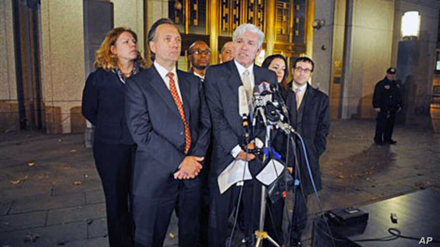 Attorneys Peter Quijano (R) and Steve Zissou address the media after their client, Ahmed Ghailani, was acquitted of all but one charge accusing him of a deadly 1998 plot to bomb two U.S. embassies in Africa, 17 Nov 2010 in New York