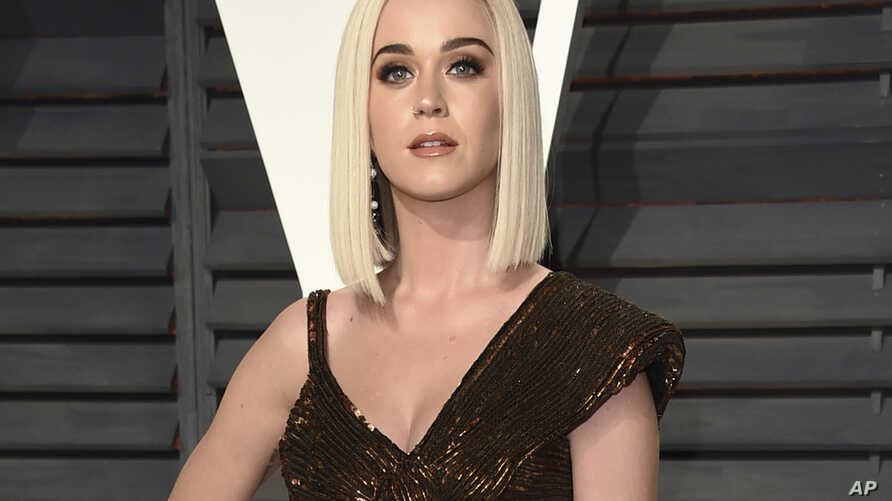 FILE - Katy Perry arrives at the Vanity Fair Oscar Party in Beverly Hills, California, Feb. 26, 2017. Perry opened up about having suicidal thoughts during a marathon weekend livestream event.