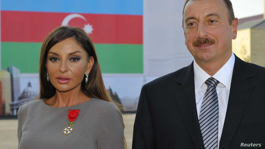 FILE - Azerbaijan's President Ilham Aliev (R) and first lady Mehriban Aliyeva pose after she was awarded with the Legion d'Honneur medal in Baku.