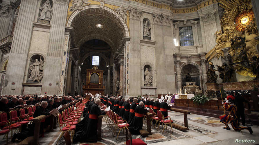 Cardinals attend a prayer at Saint Peter's Basilica in the Vatican, March 6, 2013.