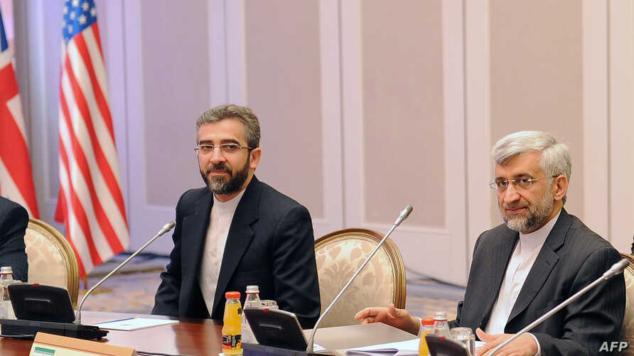 Iran's representatives led by their top nuclear negotiator Saeed Jalili (R) take part in talks with top officials from the United States, Britain, France, EU, China, Germany and Russia on Iran's nuclear program in the Kazakh city of Almaty, April 5,