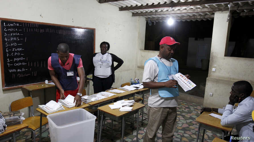 Election officials count ballot papers after the closing of the national election in the capital Luanda, Angola, August 31, 2012.