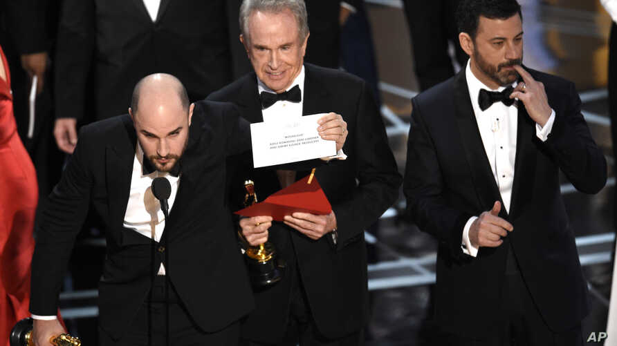 """Jordan Horowitz shows the envelope revealing """"Moonlight"""" as the true winner of best picture at the Oscars, Feb. 26, 2017, at the Dolby Theatre in Los Angeles."""