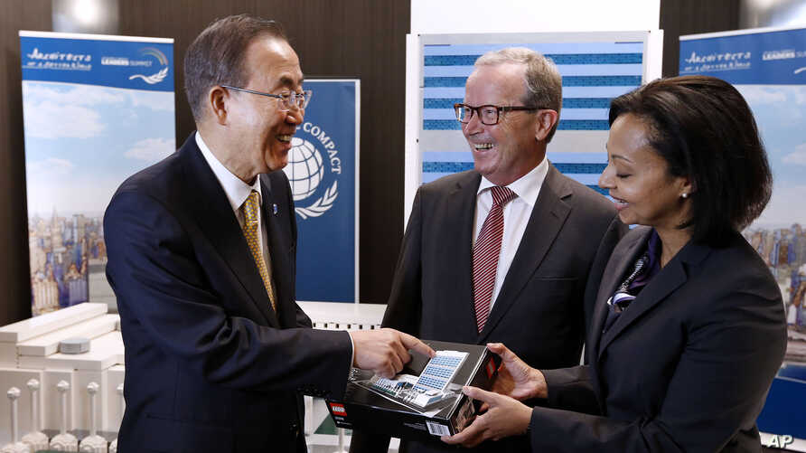 FILE - From left, U.N. Secretary-General Ban Ki-moon converses with LEGO Foundation Chairman Kjeld Kirk Kristiansen and CEO Dr. Randa Grob-Zakhary before adding the last LEGO element to a large scale LEGO model of U.N. Headquarters, built as part of