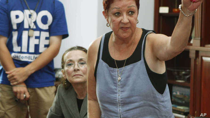 FILE - Norma McCorvey, the plaintiff in the landmark lawsuit Roe v. Wade, participates with other anti-abortion demonstrators in discussions inside then-House Speaker Nancy Pelosi's office on Capitol Hill in Washington, July 28, 2009.