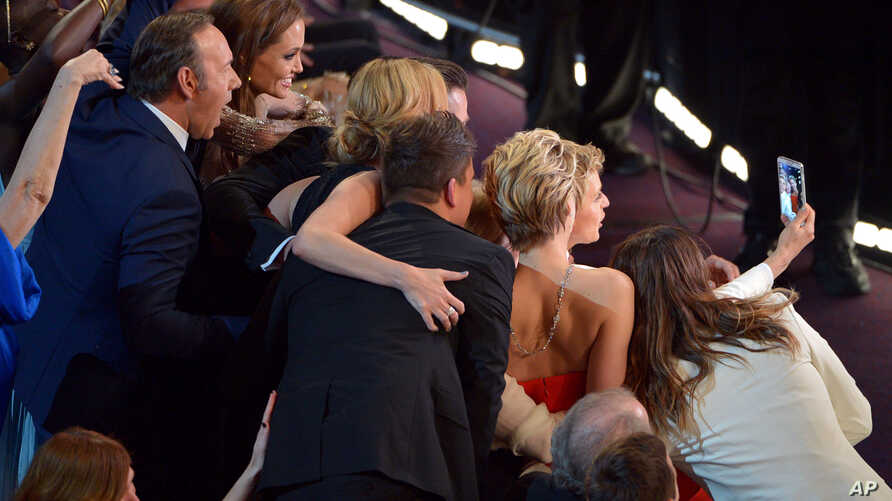 """Kevin Spacey, from left, Angelina Jolie, Julia Roberts, Brad Pitt, Jennifer Lawrence, Ellen DeGeneres and Jared Leto join other celebrities for a """"selfie"""" during the Oscars at the Dolby Theatre on March 2, 2014, in Los Angeles."""