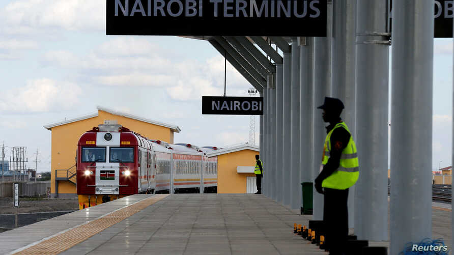 A train launched to operate on the Standard Gauge Railway line constructed by the China Road and Bridge Corporation and financed by Chinese government arrives at the Nairobi Terminus on the outskirts of Kenya's capital Nairobi, May 31, 2017.