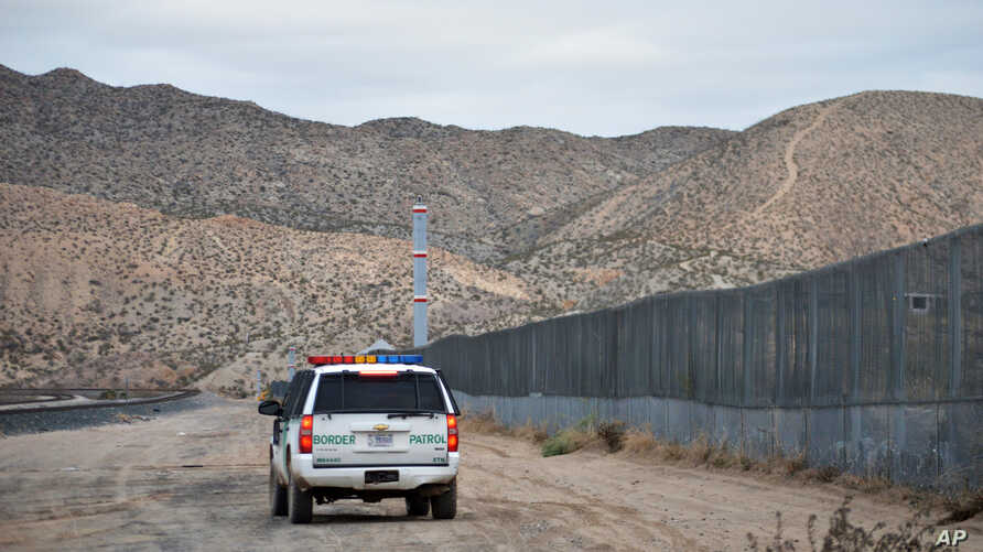 FILE - In this Jan. 4, 2016, file photo, a U.S. Border Patrol agent patrols Sunland Park along the U.S.-Mexico border next to Ciudad Juarez.