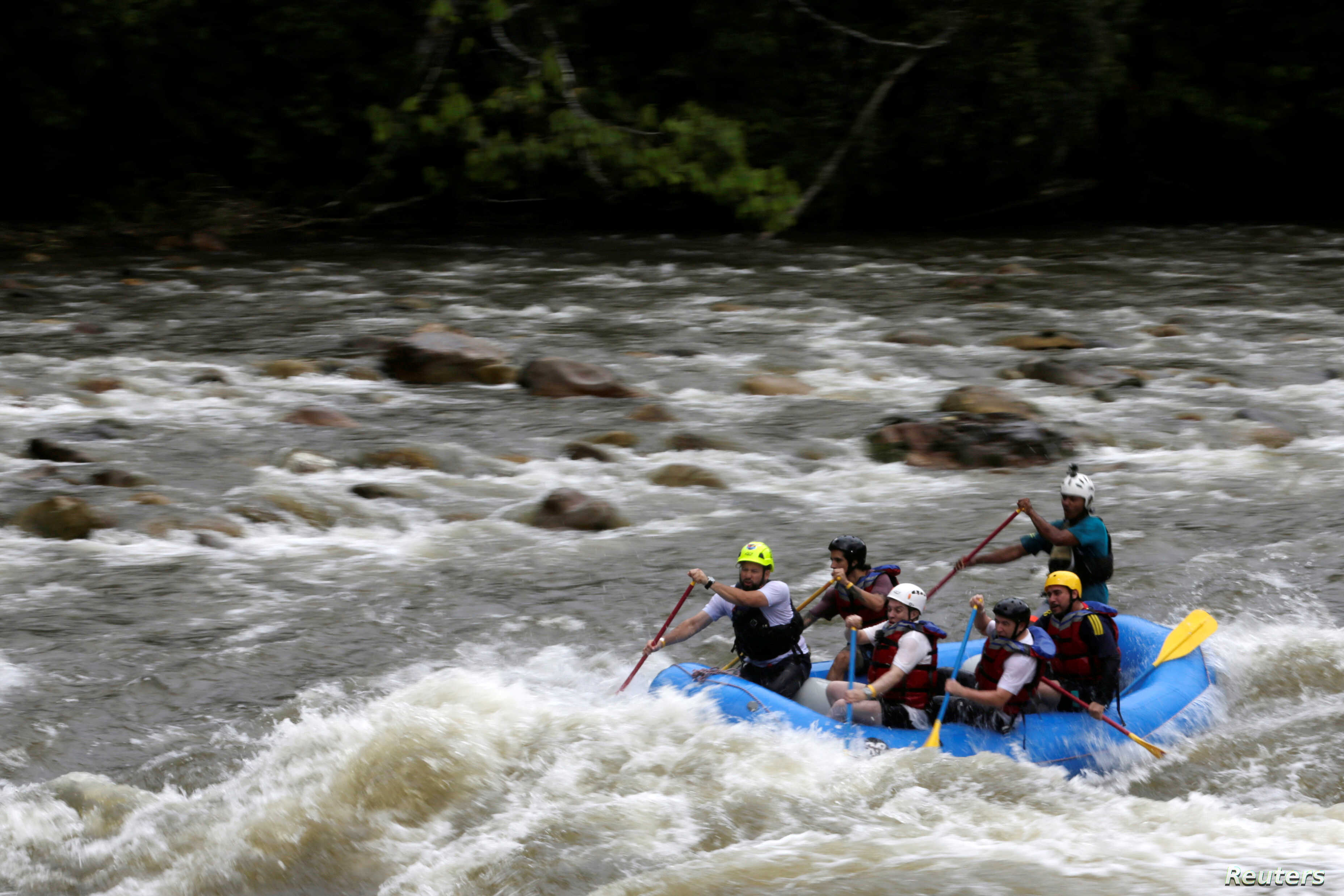 An former-FARC rebel guides a group of the press and government representatives down a river in the Caqueta provine in Miravalle, Colombia, Nov. 9, 2018.