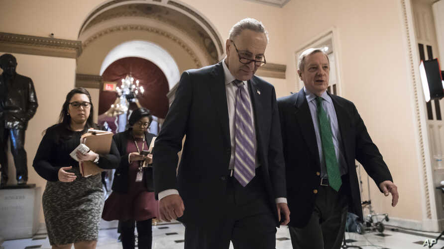 Senate Minority Leader Chuck Schumer, D-N.Y. (L) walks with Sen. Dick Durbin, D-Ill., the minority whip, as lawmakers continue negotiating on a deal that would include a fix for the Deferred Action for Childhood Arrivals (DACA) program, at the Capito