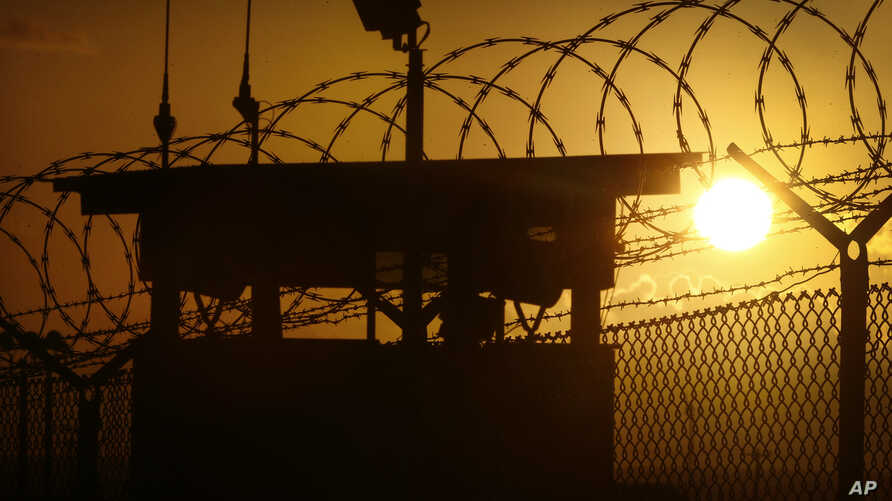 FILE - The sun rises above Camp Delta at Guantanamo Bay Naval Base, Cuba. Five Taliban commanders were released by the United States in a prisoner swap to win the freedom of U.S. soldier Sgt. Bowe Bergdahl on May 31, 2014.