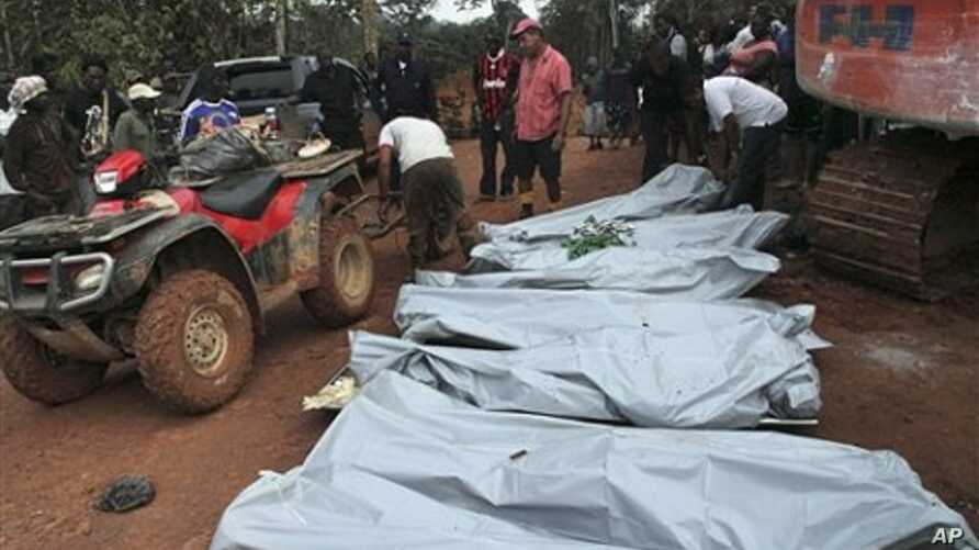 Workers help evacuate bodies of unauthorized miners from pit mine that collapsed the previous evening, killing at least seven, on the grounds of a gold mining concession operated by multinational joint venture Surgold, in the remote Sipaliwini distri