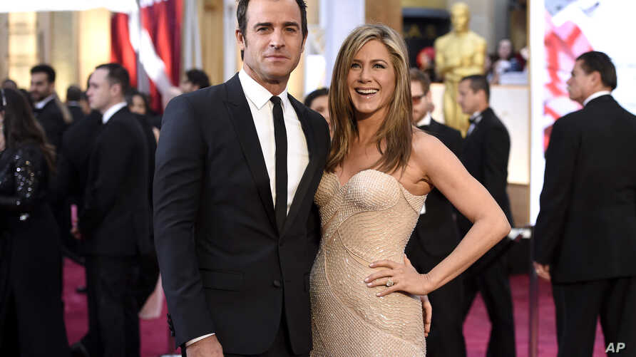 FILE - Justin Theroux, left, and Jennifer Aniston arrive at the Oscars.