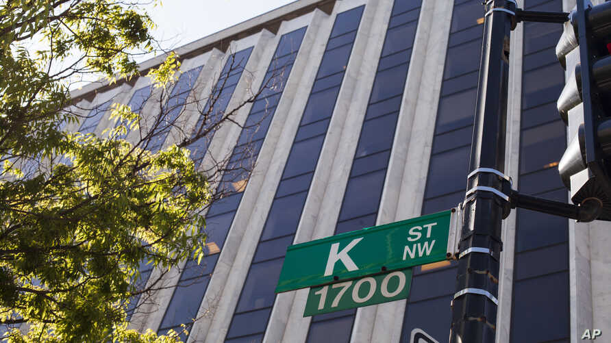 """FILE - Known as a center for lobbyists, lawyers, and think tanks, the K Street corridor is seen in northwest Washington at 18th Street, May 3, 2018. In political discourse, """"K Street"""" has become synonymous with the effort by high-power advocacy group"""