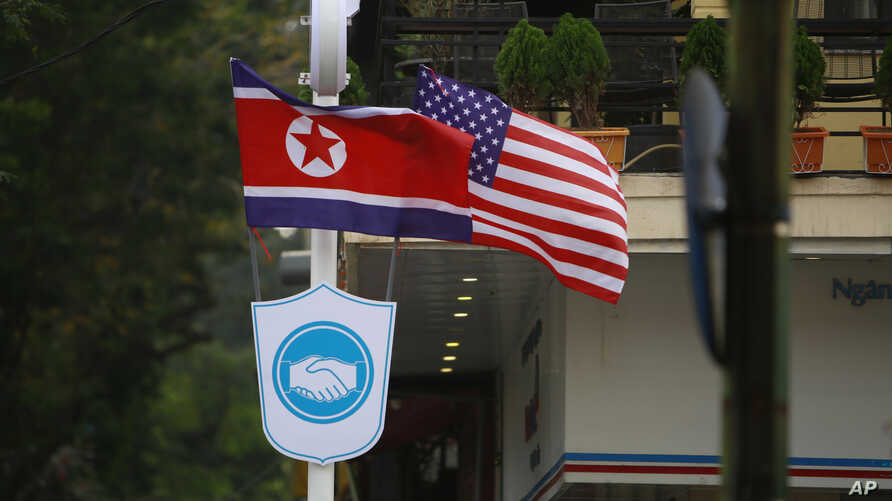 FILE - Flags of North Korea and the U.S are flown on a street in Hanoi, Vietnam, Feb. 19, 2019.
