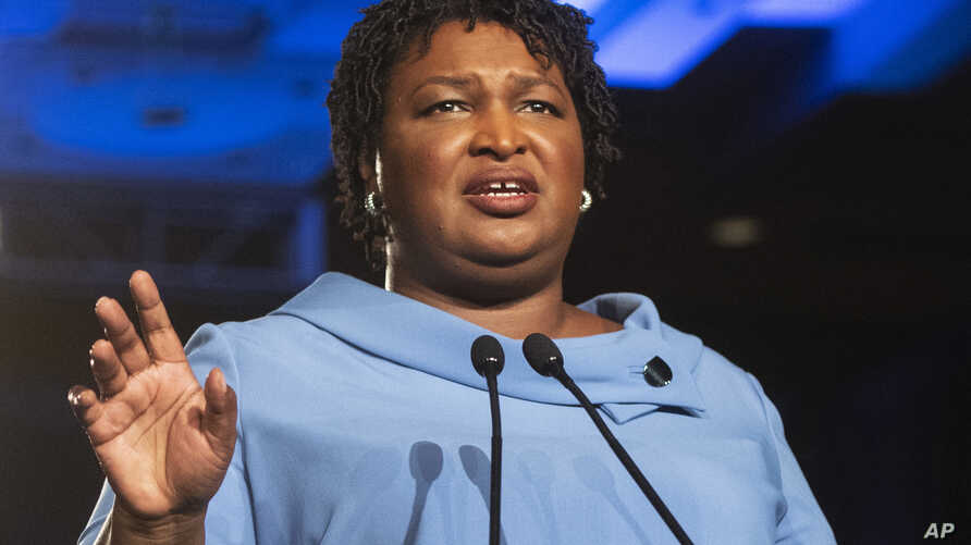 FILE -Georgia Democratic gubernatorial candidate Stacey Abrams addresses supporters during an election night watch party in Atlanta,  Nov. 6, 2018.