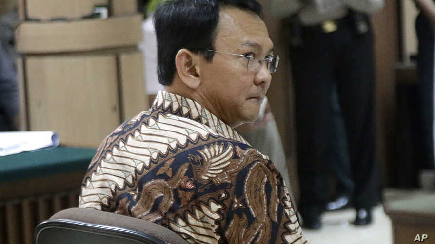 "Jakarta Governor Basuki Tjahaja Purnama, popularly known as ""Ahok"", sits on the defendant's chair during his trial at the North Jakarta District Court in Jakarta, Indonesia, Dec. 13, 2016."