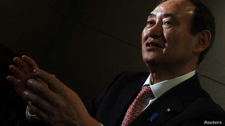 FILE - Japan's Chief Cabinet Secretary Yoshihide Suga speaks during an interview with Reuters in Tokyo.