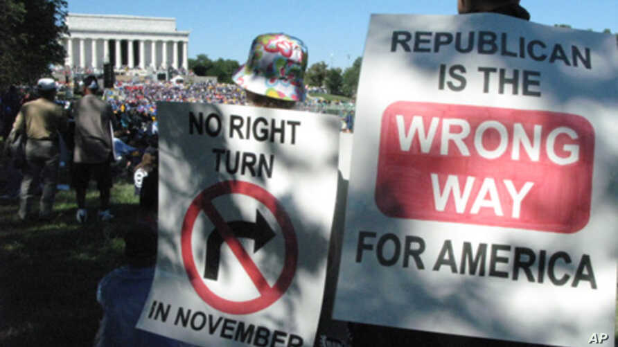Protesters hoping Democrats will retain control of Congress after the November elections listen to speeches at the Lincoln Memorial.