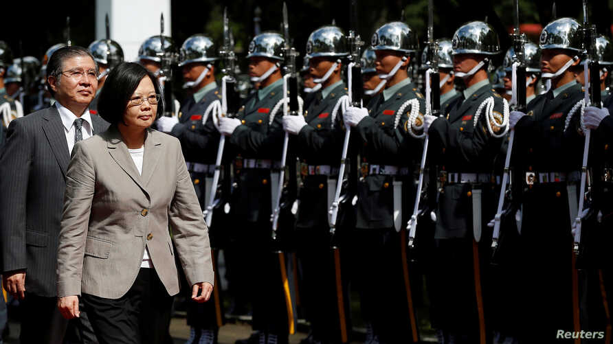 Taiwanese President Tsai Ing-wen inspects honour guard before a ceremony to mark the 92nd anniversary of the Whampoa Military Academy, in Kaohsiung, southern Taiwan, June 16, 2016.