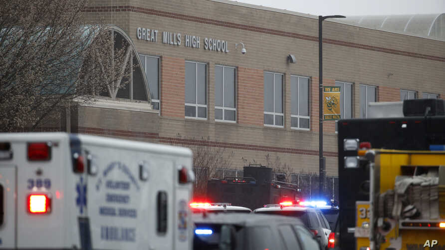Deputies, federal agents and rescue personnel, converge on Great Mills High School, the scene of a shooting, Tuesday morning, March 20, 2018 in Great Mills, Md.