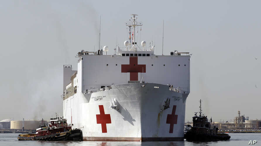 FILE - The Navy hospital ship USNS Comfort returns to port in Baltimore, March 19, 2010.