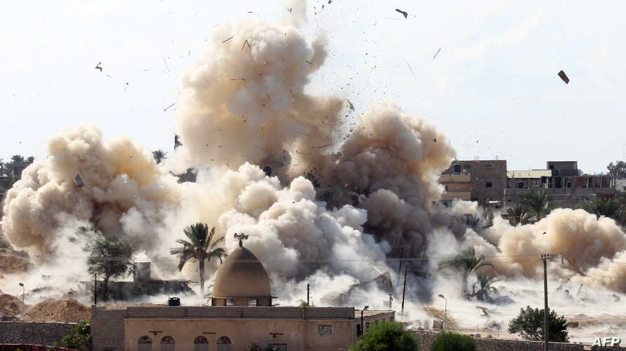 TOPSHOTSSmoke rises after a house was blown up during a military operation by Egyptian security forces in the Egyptian city of Rafah near the border with southern Gaza Strip October 29, 2014, as Egypt began setting up a buffer zone along the border w