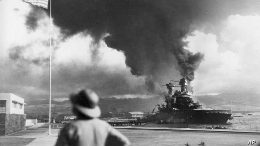 American ships burn during the Japanese attack on Pearl Harbor, Hawaii on Dec. 7, 1942.