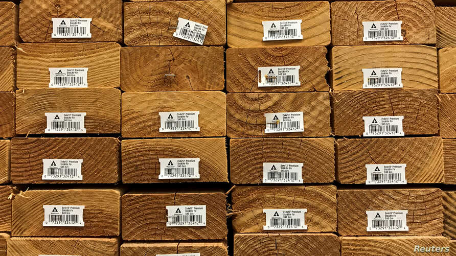 FILE - U.S.-made softwood lumber is shown for sale in Los Angeles, California, April 26, 2017.