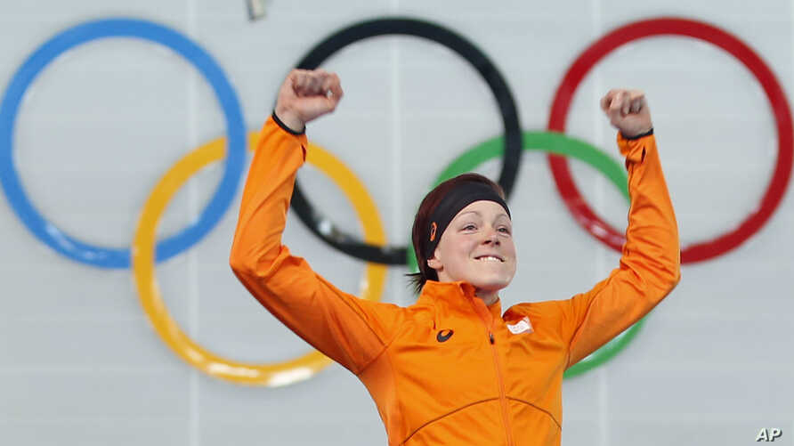 Gold medalist Jorien ter Mors of the Netherlands jumps in celebration during the flower ceremony for the women's 1,500-meter speedskating race at the Adler Arena Skating Center during the 2014 Winter Olympics in Sochi, Russia, Sunday, Feb. 16, 2014.