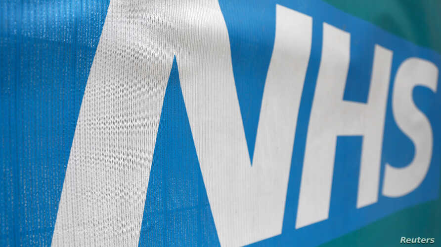 An NHS logo is displayed outside a hospital in London, Britain, May 14, 2017.