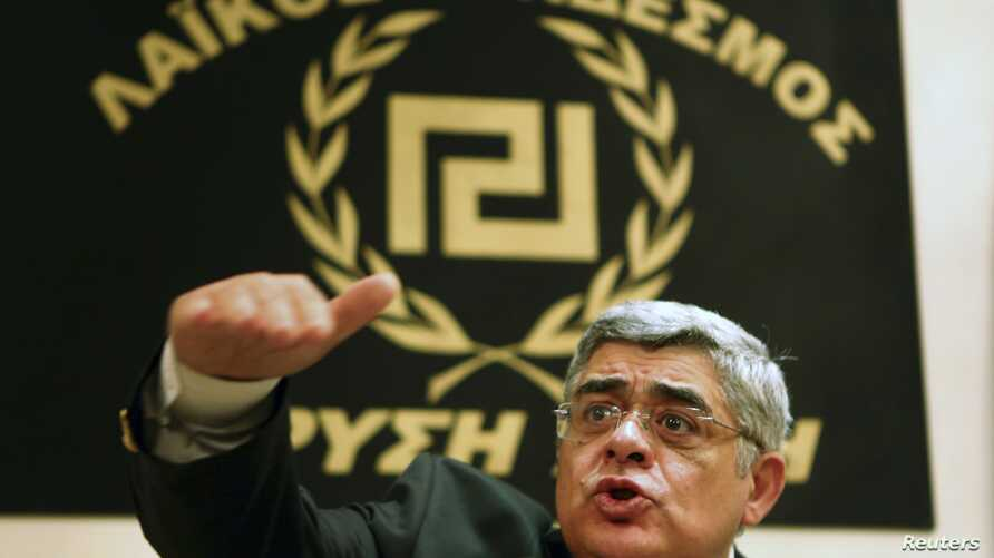 Leader of extreme-right Golden Dawn party Nikolaos Mihaloliakos talks to reporters, Athens, May 6, 2012.